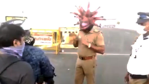 कोरोना हेलमेट पहनकर पुलिस लोगों कर रही जागरूक, घर से निकलने के लिए कर रहे मना